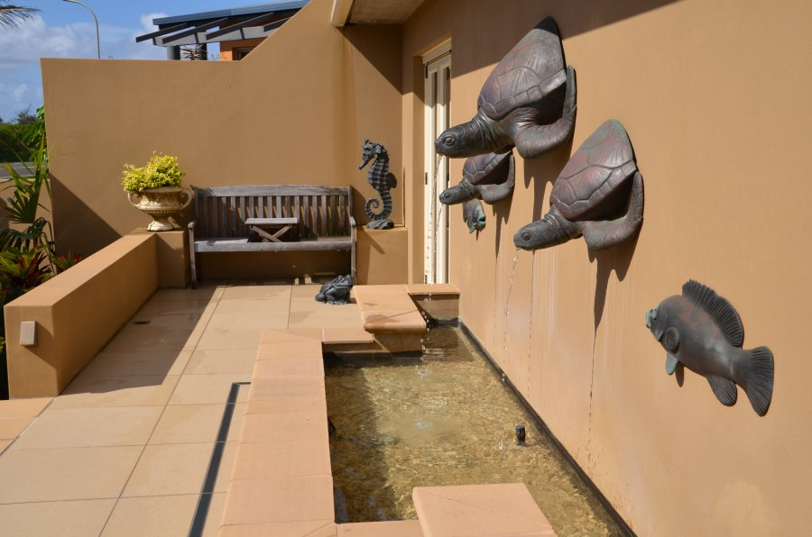 Bronze sculptures of Large Turtle and Small Wall Turtles with half bronze Fish installed as a water feature
