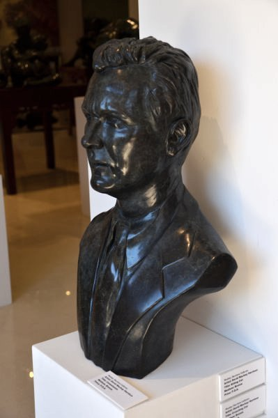 Finished bronze sculpture of Wayne Sharpe, founder of Barter Card Australia